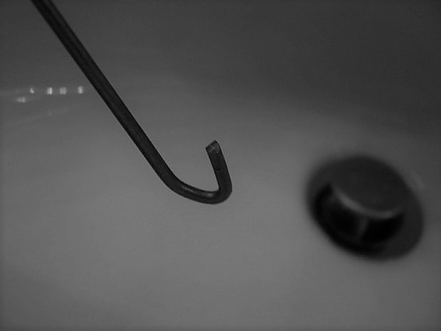 How to Use a Coat Hanger to Unclog Your Drain
